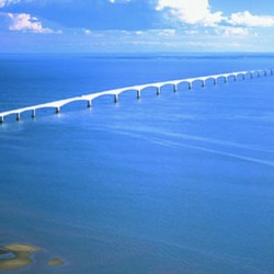 Travel to PEI on the Confederation Bridge.