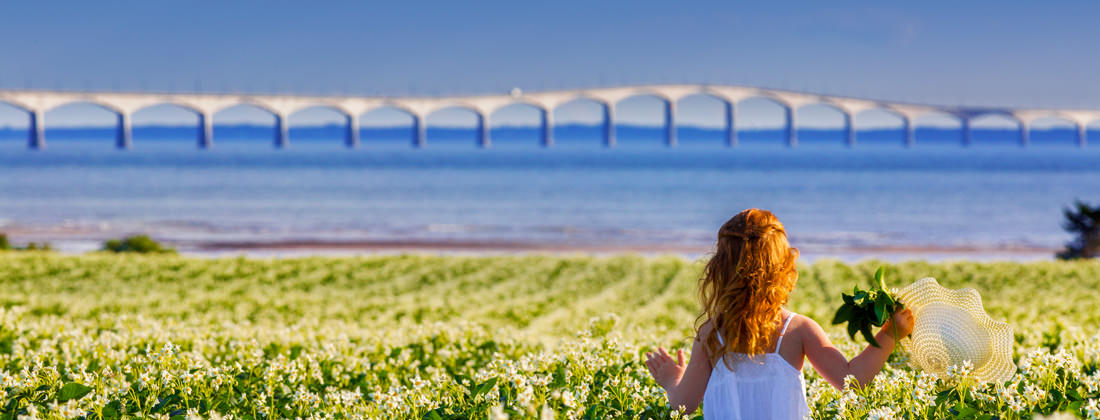 Girl in field at Confederation Bridge